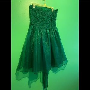Green cocktail dress with black polka dots